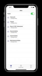 iPhone mit laufender BlindFind-App welche sämtliche, in der Nähe befindlichen Ziele auflistet.
